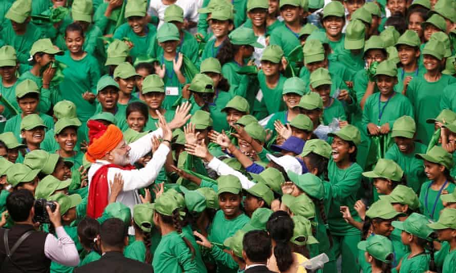India's prime minister Narendra Modi, with schoolchildren in Delhi, 2018.