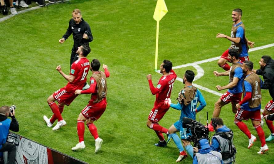Saied Ezatolahi celebrates scoring against Spain – but his goal was disallowed for offside.