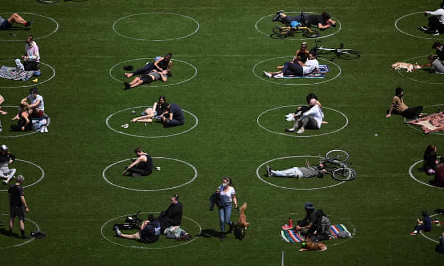 People practicing social distancing in white circles in Domino Park, Williamsburg, in Brooklyn Sunday.