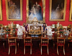 London, UK. Royal Collection employees recreate a Victorian dinner in the state dining room featuring the Alhambra fountain at the centre of the table for an exhibition to mark the 200th anniversary of the birth of Queen Victoria, for the summer opening of Buckingham Palace