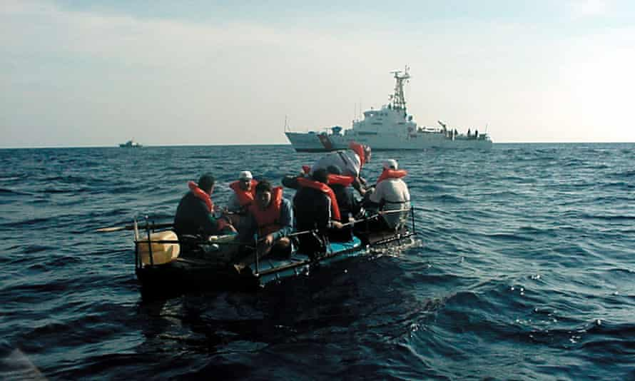 The Coast Guard cutter Key Largo intercepted eight Cuban migrants 25 miles off Cuba. The migrants were drifting in a raft made of 55-gallon drums.