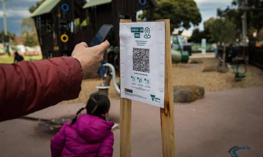 A parent uses the QR code check-in at a playground in Melbourne on 3 September.