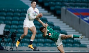 Johnny May beats Hugo Keenan of Ireland in the air before going on to score England's first try