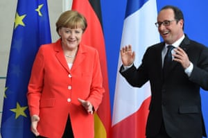 French President Francois Hollande (R) and German Chancellor Angela Merkel (L) chat after a joint press conference following their meeting at the Chancellery on May 19, 2015 in Berlin. Hollande and Merkel met for talks likely to focus on Greece, Ukraine and Britain's future in the EU. AFP PHOTO / TOBIAS SCHWARZTOBIAS SCHWARZ,TOBIAS SCHWARZ/AFP/Getty Images