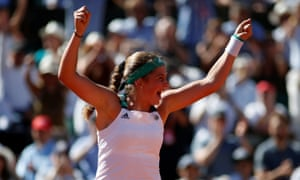 The unseeded Jelena Ostapenko celebrates winning the final against Simona Halep.