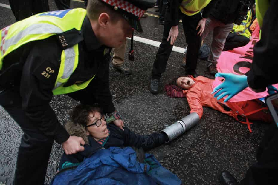 Activists lock themselves together and superglue themselves to the ground