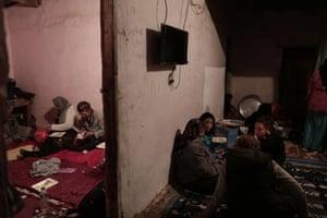 Women eat in Umm Yasser's home
