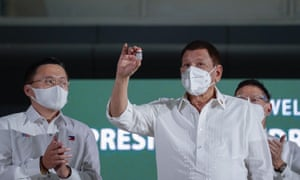 Philippine President Rodrigo Duterte holding a vial of the AstraZeneca Covid-19 vaccine during a ceremony at a military airbase in Manila.