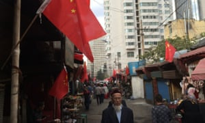 "Chinese flags in the western region of Xinjiang, where the editor of the state-run newspaper has been sacked for ""improperly"" discussing Beijing's policies in the violence stricken area.<br>"