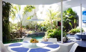 Rounding up: the all-white plant-filled interior is centred on the swimming pool.