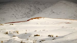 The desert received its first sprinkling of snow in recent decades just before Christmas, when a few flakes settled on the dunes