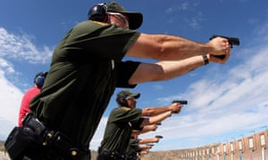 Trainees take part in their first day on the firing range at the U.S. Border Patrol Training Academy in Artesia, New Mexico, August 18, 2006.