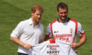 Prince Harry is presented with a personalised Leeds Rhinos shirt in his early days as patron of the Rugby Football League