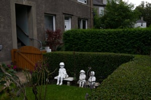 Figurines of children sit in the front garden of a home in Warriston.