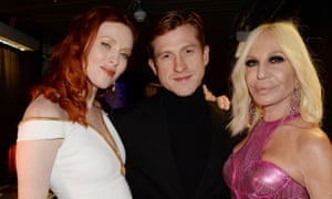 Daniel Lee poses with Karen Elson, left, and Donatella Versace at the British Fashion Awards