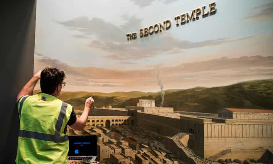 A painter works on a mural during the construction of the Museum of the Bible in Washington.