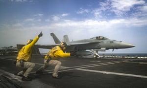 An F-18 Super Hornet takes off from the deck of the USS Abraham Lincoln aircraft carrier in the Arabian Sea.