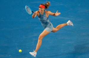 A leaping Maria Sharapova sends a return back to Rebecca Peterson.