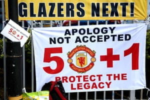 Protesters call for the club to adopt the 50+1 ownership model.