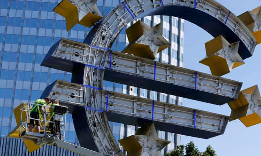 Workers dismantle euro sign sculpture in front of the former ECB headquarters in Frankfurt.