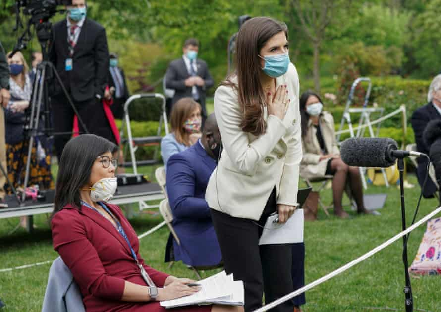 CNN correspondent Kaitlan Collins, center, tries to ask a question on the heels of Donald Trump's exchange with CBS News correspondent Weija Jiang, left.