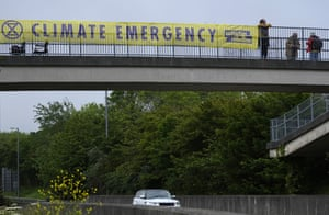 A banner covers the side of an overpass on a road leading to the G7 summit near St Ives