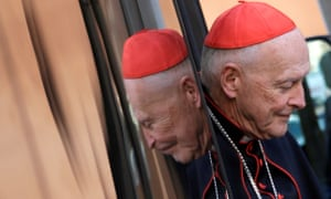 Man in the mirror: Cardinal McCarrick arrives for a meeting at the Synod Hall in the Vatican in 2013.