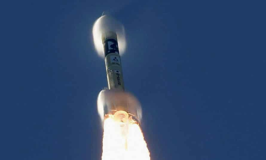 An H-2A rocket carrying the Hope Probe lifts off from the launching pad at Tanegashima Space Center
