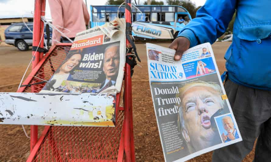A news vendor in Kiambu, Kenya, offers a newspaper reporting on Joe Biden's election win earlier this month.