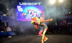 A dancer takes a bow while promoting Just Dance 2017 by Ubisoft during E3,