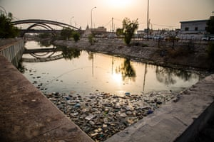 A Basra canal littered with plastic and debris