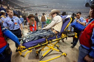 An injured bareback rider is wheeled from the arena on a stretcher in 2012