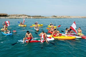 Demonstrators take to the water for an anti-government protest in Sidon, Lebanon