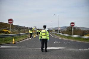 A gardaí police officer mans a checkpoint