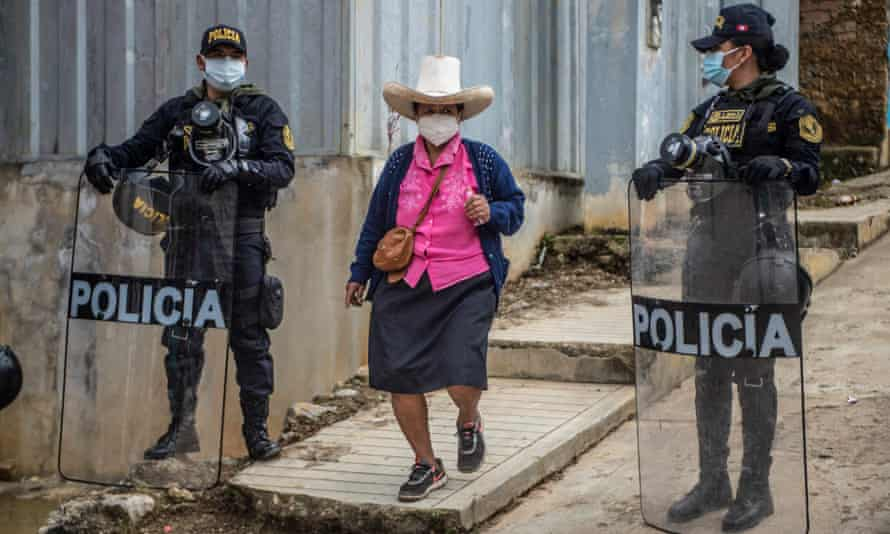 A woman arrives to cast her vote at a polling station in Tacabamba on 6 June.