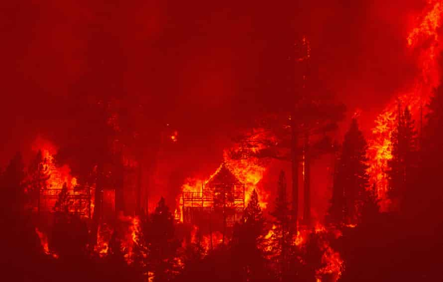 Flames consume homes as the Caldor fire pushes into South Lake Tahoe.