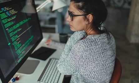 Young woman programming at her home office.