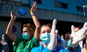 Healthcare workers dealing with the coronavirus crisis in A Coru??a applaud in return as they are cheered on outside the city???s university hospital