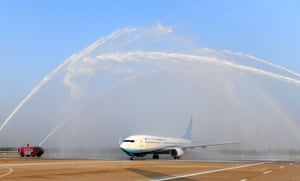A flight from Hangzhou is welcomed on arrival in Wuhan