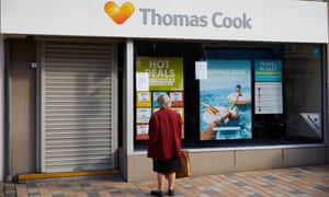 A woman looks at a notice outside a Thomas Cook store in Blackpool