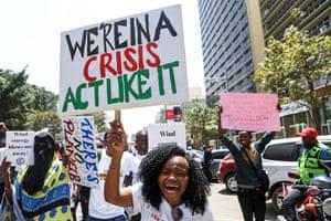 Students hold placards in Nairobi, Kenya