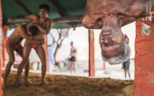 Spirit of Travel winner, Matt Parry (UK)'64-year-old SiyaRam hangs from the beams above the wrestling pit in Varanasi, India, in the middle of doing stomach crunches as part of an intense warm up routine that belied his age. I was in India on an assignment and had wanted to photograph a Kushti wrestling akhara. This form of the sport is steeped in history, culture and tradition but is gradually dying out due to government pressure for participants to move on to a modern mat-based wrestling format in order to compete at international level. SiyaRam has been training in this akhara for 13 years, and what started as a hobby is now a major part of his daily life.'