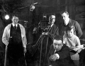 """The Mountain Eagle (1926) For many years this posed image of the young Hitchcock """"directing"""" in the foreground was the only known picture from the silent film. Alma Reville, the future Mrs Hitchcock, is seen taking notes"""