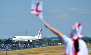 An England fan greets the England team as they touch down in Birmingham