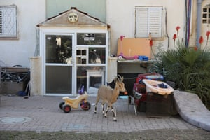 A Nubian ibex inspects children's toys outside of a residential home