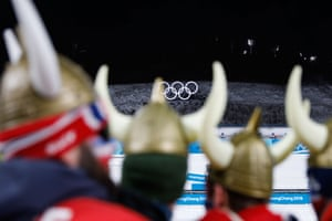 Fans of Norway's Johannes Thingnes Boe look on during his victory ceremony in the men's 20km individual biathlon.