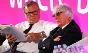 Sir Martin Sorrell and Bernie Ecclestone. The takeover deal was fuelled with a mixture of cash and shares in Liberty handed to F1's management.