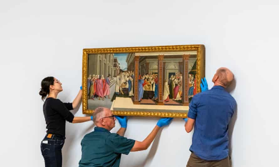 NGA staff hang Botticelli's Scenes from the Early Life of St Zenobius
