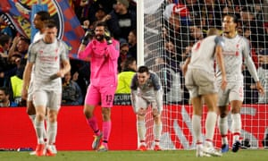 Liverpool's Alisson and team mates react after conceding their second goal scored by Barcelona's Lionel Messi.