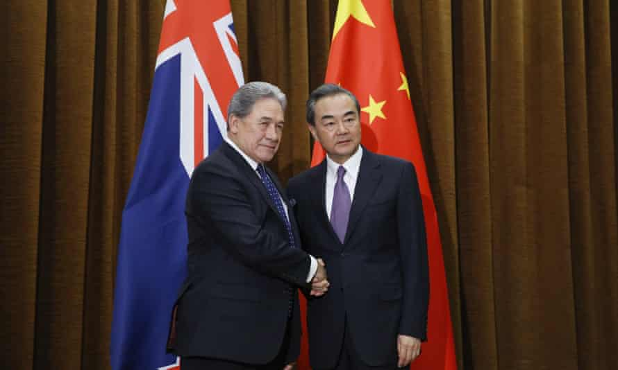 China's foreign minister Wang Yi shakes hands with New Zealand's foreign minister Winston Peters in Beijing on 25 May